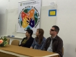 Na imagem, Adilso Corlassoli, vice-presidente do COEPEDE está a direita. Ao seu lado, duas mulheres. Ambos sentados. No fundo, baner do evento.